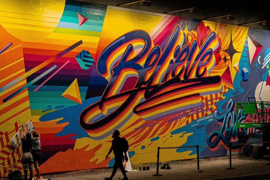 grafitti word believe on building wall