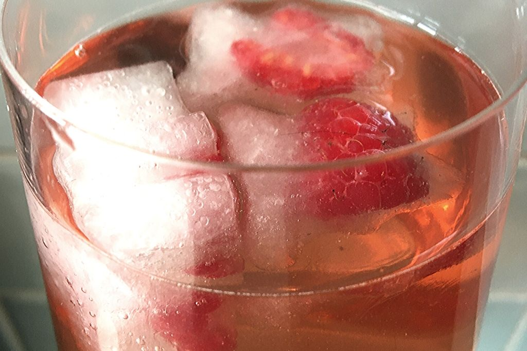 pink drink with raspberry ice cubes