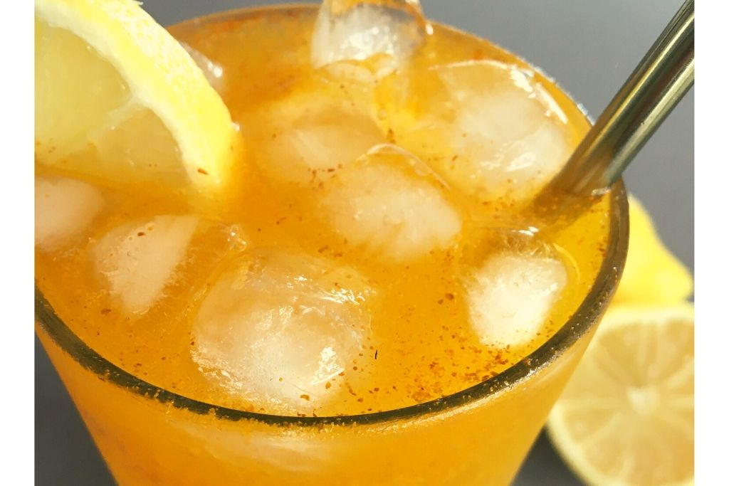 golden drink with ice