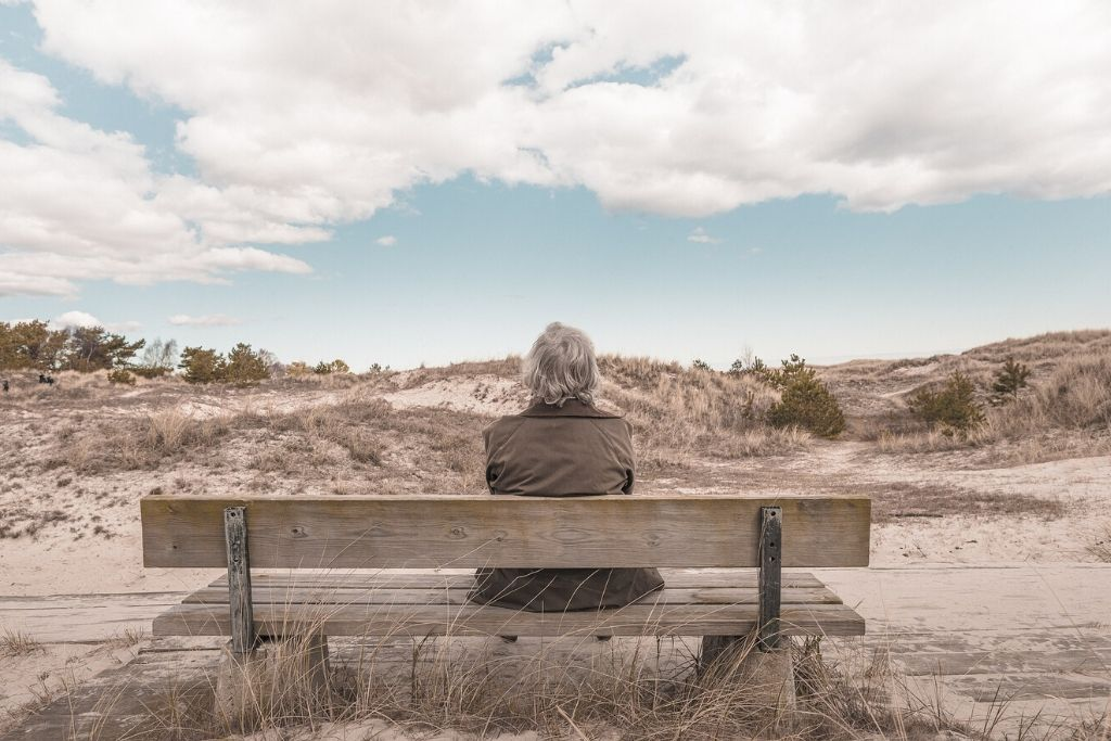woman alone on bench